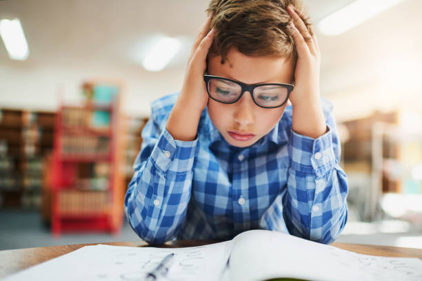 Young Boy feeling Stressed in Classroom